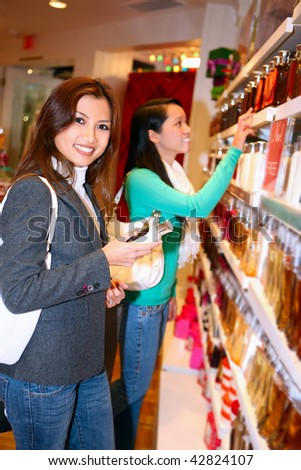 A pretty asian woman shopping for the holidays - stock photo