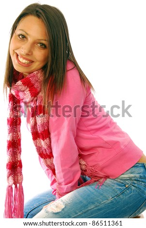 A pretty brunette sexy posing in a pink tracksuit - stock photo