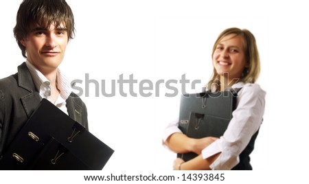A pretty elegant businesswoman and a young businessman are holding folders. They are wearing elegant white shirts. - stock photo