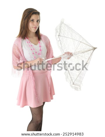 A pretty in pink teen girl opening a lacy white parasol.  On a white background. - stock photo