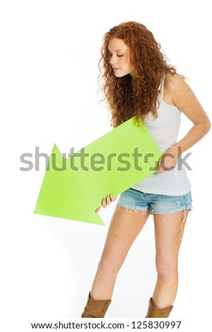 A pretty woman holding an arrow pointing down. - stock photo