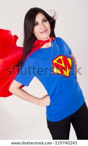 A Pretty Woman Mom Super Model Mother Superhero Hero Character Uniform Proudly Smiling - stock photo