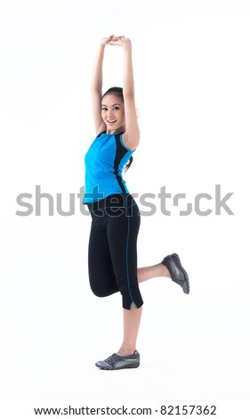 A pretty woman stretching her hands for exercise - stock photo