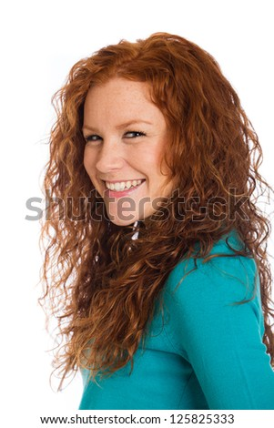 A pretty woman with beautiful red hair. - stock photo