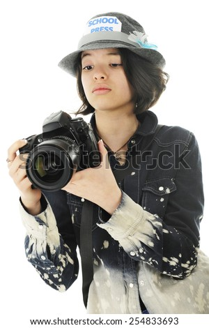 A pretty young teen checking camera settings while getting  photographs for her school yearbook.  On a white background. - stock photo