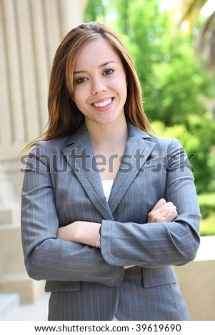 A pretty young woman at the school campus - stock photo