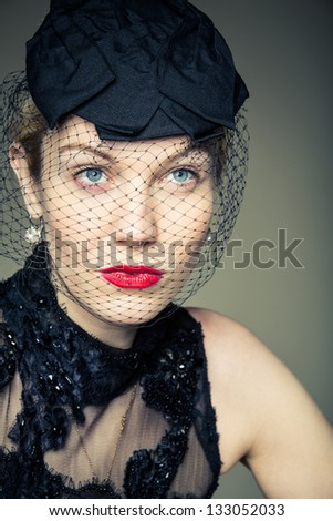 A pretty young woman in a black veil - stock photo