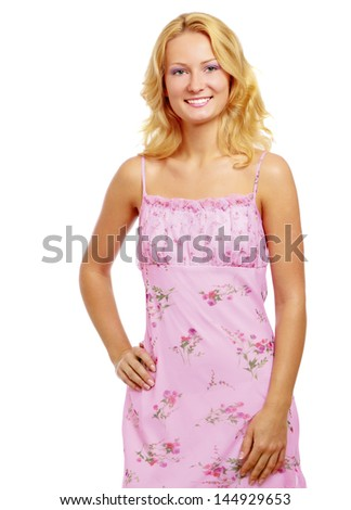 A pretty young woman wearing a nice summer dress, isolated on white - stock photo