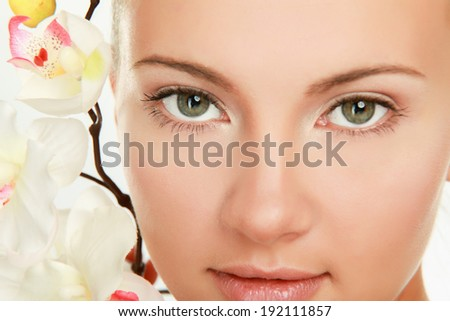 A pretty young woman with a flower - stock photo