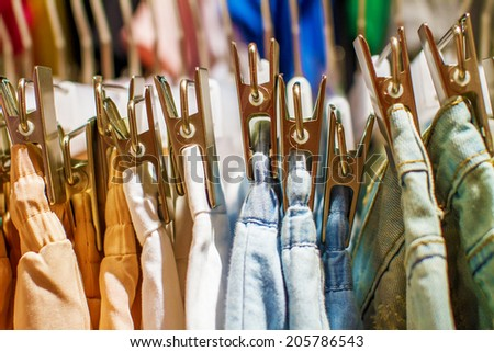 a Preview jeans hanging on a hanger in the store  - stock photo