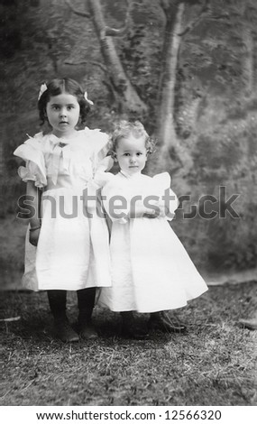 A print from a glass negative taken in an an old view camera about 1890. Two little girls. - stock photo
