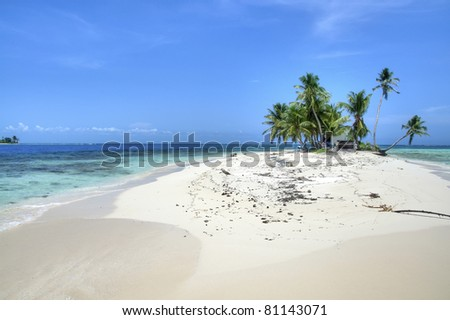 A Private Island in Belize Surrounded by Turquoise Water - stock photo