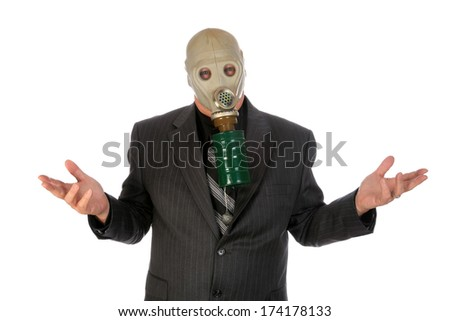 A professional Business Man in a Grey Pin Stripe Suit, wears a green Gas Mask representing, Global Warming, Corporate Greed, Pollution, Big Business, Industrial Waste, Toxic Waste and other concepts.  - stock photo