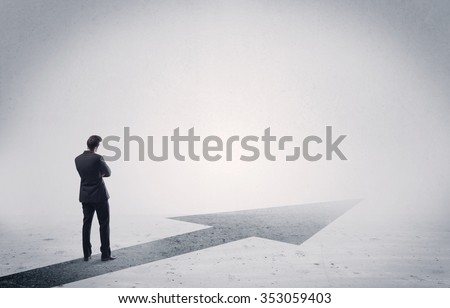 A professional businessman thinking while standing on a black arrow pointing forward in grey space concept - stock photo