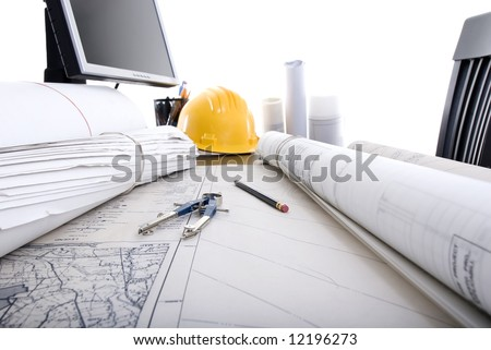 A professional desktop of an Engineer with drawings computer. - stock photo