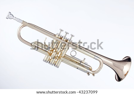 A professional gold brass trumpet isolated against a white background in horizontal format. - stock photo