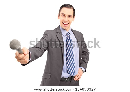 A professional male reporter holding a microphone isolated on white background - stock photo