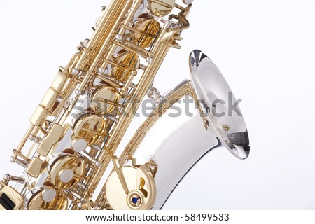 A professional saxophone isolated against a white background in the vertical format. - stock photo