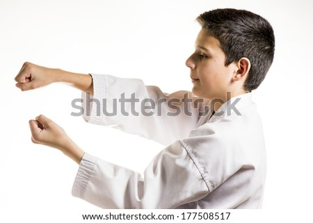 A profile of  a child in a karate fight stance. - stock photo