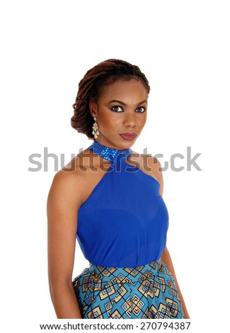 A profile portrait of a beautiful African American woman with braided hair standing in a blue blouse isolated for white background.  - stock photo