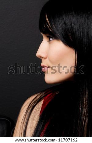 A profile shot of a beautiful woman - stock photo
