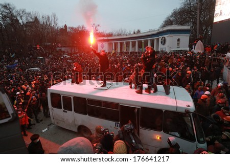 A protester stands on a bus with a lighted fireworks. Kyiv, Ukraine, January 19, 2014 - stock photo