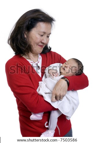 A proud grandmother hold her new granddaughter for the first time. - stock photo