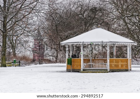 A public pavillion in a snow covered park in Helsingborg, Sweden. - stock photo