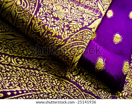 A purple and yellow saree folded with beautiful embroidery - stock photo