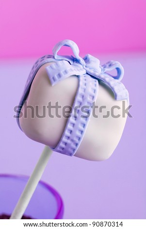 a purple cakepop with a bow - stock photo