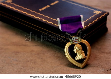 A Purple Heart Military Decoration Draped in Front of its Box 2 - stock photo