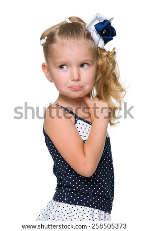 A puzzled little girl looks back against the white background - stock photo