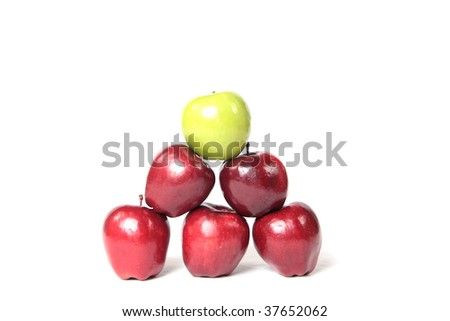 A pyramid of green and red apples. - stock photo