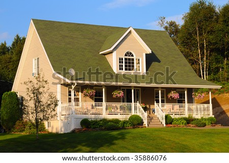 A quaint cottage style house set in northeastern North America - stock photo