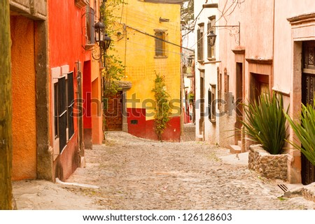 A quaint scene on the narrow colonial streets of San Miguel de Allende, Guanajuato Mexico - stock photo