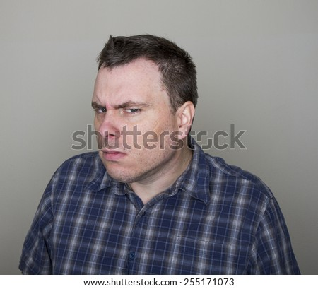 a questioning or angered look at the camera - stock photo