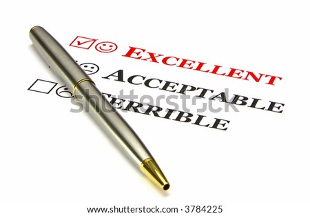 """A questionnaire with the top choice, """"excellent"""", filled in by default. Gold and silver pen in the foreground. - stock photo"""
