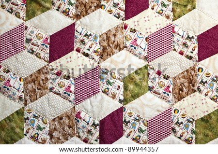 A quilt with beautiful colors in a pattern of squares and decoration for children - stock photo