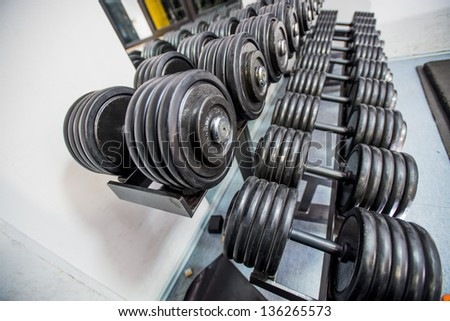 A rack of dumbbells weights - stock photo