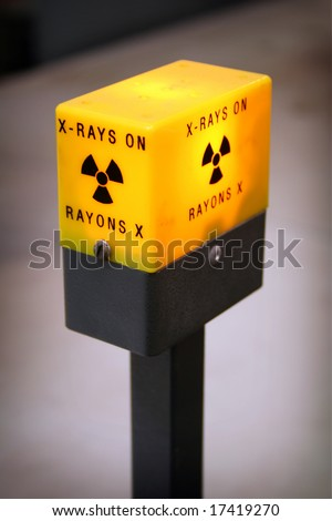 A radiation alert light used on an X-Ray Diffraction Machine. The light lets users know the machine is on and radiation is contained within it. Similar lights are found on medical equipment. - stock photo