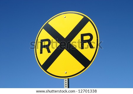 A railroad sign on a blue sky background. - stock photo