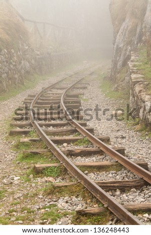 A railway during a foggy day - stock photo
