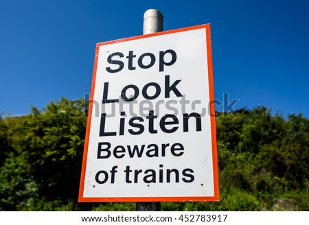 A railway pedestrian crossing sign warning in England. - stock photo