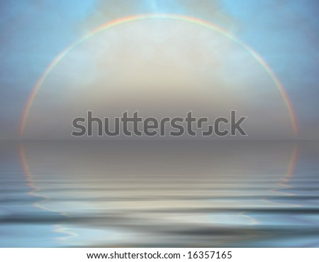 A rainbow over the sea - stock photo