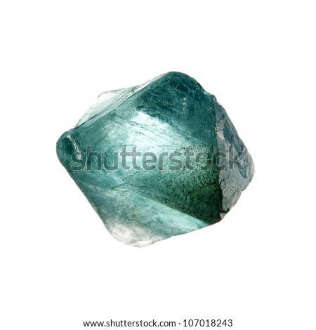 A raw crystal of fluorite, illuminated from behind - stock photo