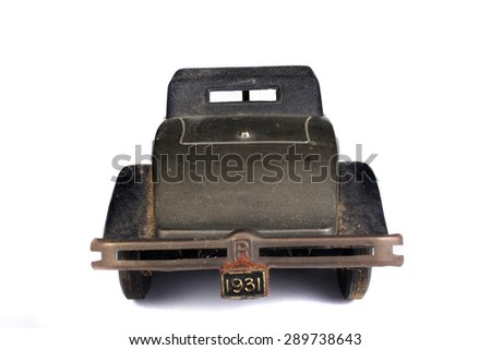 A rear view of a antique vintage car, on white studio background. - stock photo