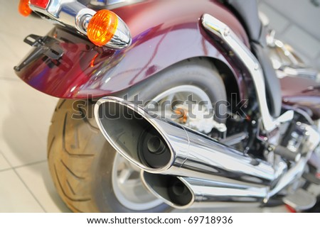 A rear view of a motorcycle - stock photo