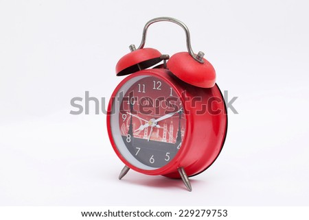 A red alarm clock isolated on white background - stock photo