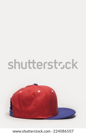 A red and blue cap side view isolated white background. - stock photo