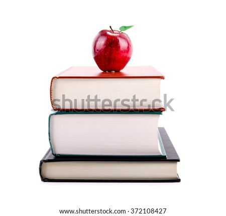 A red apple on a stack of books isolated on white background. Concept of education, back to school, learning, teaching, literacy. - stock photo